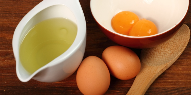 Egg and olive oil for Frizzy Hair